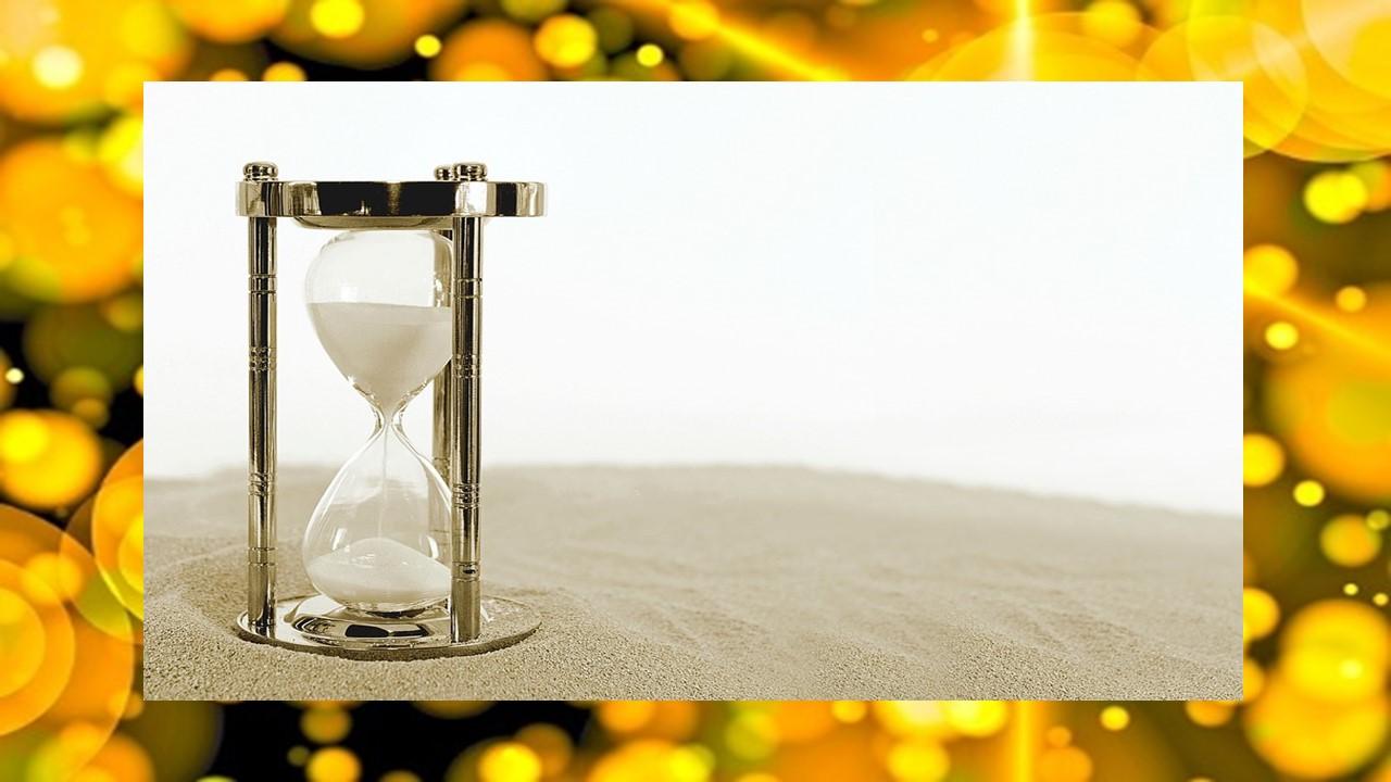 輝く光の中にある砂時計